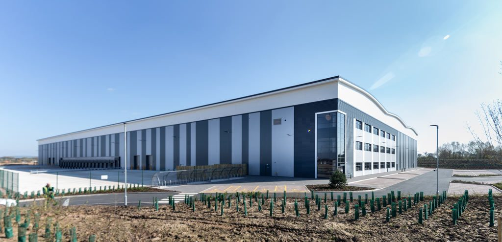 Photograph of Wide exterior view of steel structure warehouse in Stoke constructed by JD Pierce Contracts ltd.