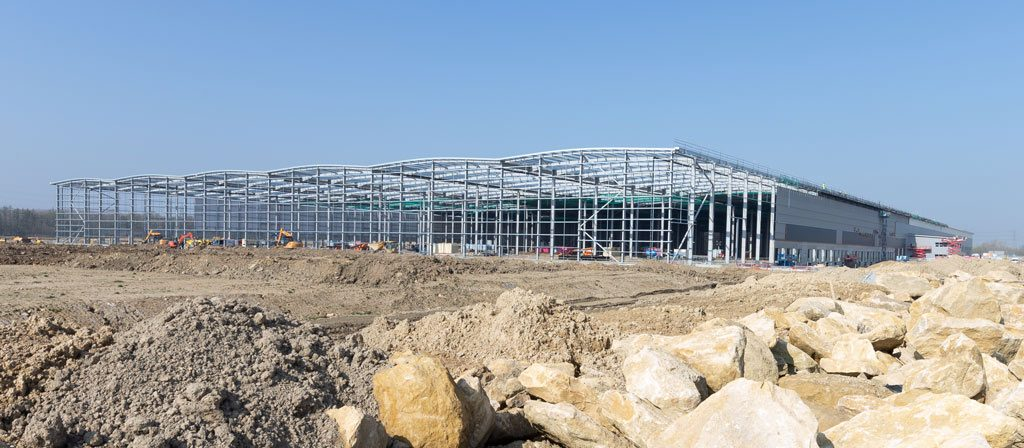 Photograph of wide-view-of-Steel-structure--construction-progress-on-Mulberry-Projects-Corby-Distribution-Centre-steelwork-and-construction-by-JD-Pierce-Contracts-Ltd-Scotland